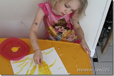 Emma paints with glue